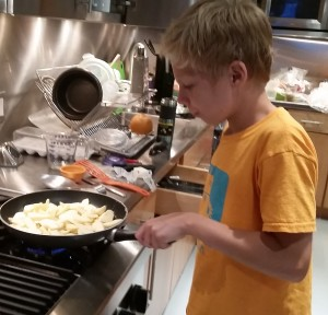 Max cooking apples in butter, sugar and cinnamon