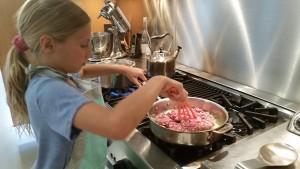 Alex cooking the ground lamb for lamb bolognese