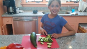 Ali chopping zucchini from our garden