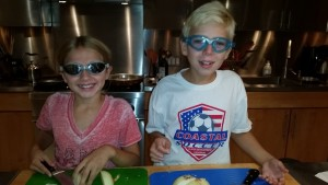 Cutting the onions for paella.  (Even though they were sweet onions, we had to wear goggles to cut them)