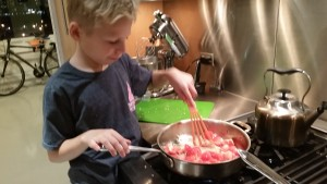 Max softening his tomatoes for his shrimp dish