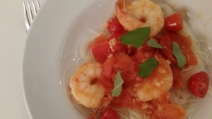 Max's dish: shrimp with tomato, garlic, basil on rice noodles.