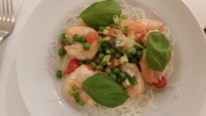 Alex's dish: shrimp with coconut milk, peas, tomatoes and garnished with basil and green onions.
