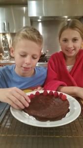 Finishing touches: Adding fresh raspberries to the cake