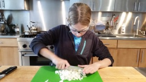 Chopping onions for the chili.