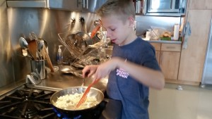 Sauteing the onions and turkey before placing them in the Chili.