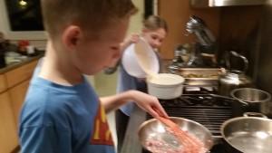 Team work: Max on pancetta, Alex on yorkshire pudding.