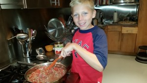 Cooking ground lamb and tomatoes for lamb ragu