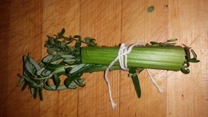 Herbs wrapped up inside celery stalks