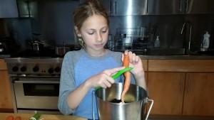 Peeling carrots for braising liquid.