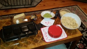Pre game appetizers: guacamole, hummus and raclette grill heating up.