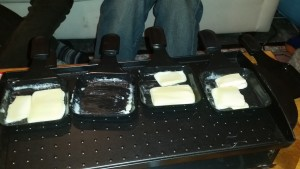 Melting raclette on our raclette grill.