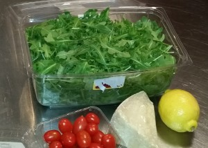Arugula, parmigiano, grape tomatoes and lemon-olive oil dressing
