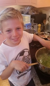 Stirring the Peas into the pan.