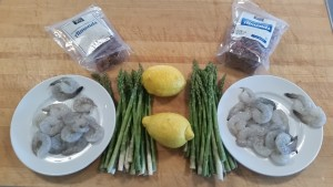 Appetizer ingredients: lemons, asparagus, shrimp and almonds