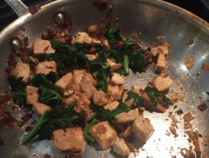 Tofu with kale, red onion and pumpkin seeds