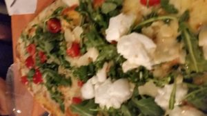 Estate pizza: fresh tomatoes, arugula, fresh mozarella, parmesano cheese